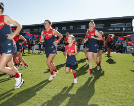 Girls AFL team running into ground